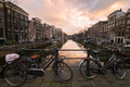 Bikes in Amsterdam at sunset - PhotoDune Item for Sale