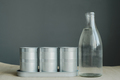 still life of glass bottle and metal pot - PhotoDune Item for Sale