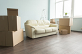 Empty room full of cardboard boxes for moving into a new home - PhotoDune Item for Sale