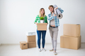 Family, new apartment and relocation concept - Young couple moving in new house - PhotoDune Item for Sale