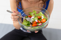 Healthy lifestyle, food concept - close up of a plate of salad in woman's hands - PhotoDune Item for Sale