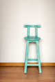 Blue Wooden Stool Against Wall - PhotoDune Item for Sale