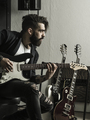 Man playing his electric guitar in a music studio - PhotoDune Item for Sale