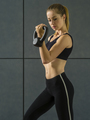 Young woman doing bicep curls with kettlebell - PhotoDune Item for Sale