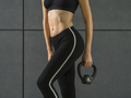 Fit young woman exercising with a kettlebell - PhotoDune Item for Sale