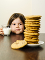 Young girl staring at pile of cookies - PhotoDune Item for Sale