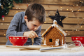 Young boy decorating gingerbread house - PhotoDune Item for Sale