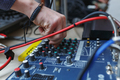 Man sets the audio level on the console audio effects. - PhotoDune Item for Sale