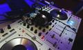 DJ mixer in bright colors disco in a nightclub. - PhotoDune Item for Sale