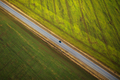 View from the height on the car driving along a rural road betwe - PhotoDune Item for Sale
