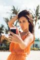 Cute girl make selfie on tropical beach. - PhotoDune Item for Sale
