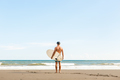 Handsome man with surfing board on spot. - PhotoDune Item for Sale