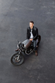 Top view to brutal man with cafe racer custom motorbike. - PhotoDune Item for Sale