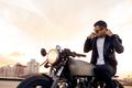 Brutal man sit on cafe racer custom motorbike. - PhotoDune Item for Sale
