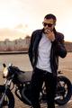 Brutal man near his cafe racer custom motorbike. - PhotoDune Item for Sale