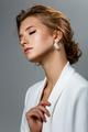 beautiful dark blonde girl in white jacket - PhotoDune Item for Sale