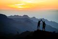 Teamwork couple climbing helping hand - PhotoDune Item for Sale