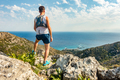 Trail runner looking at inspiring landscape - PhotoDune Item for Sale