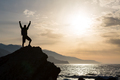 Man with arms outstretched celebrate mountains sunrise - PhotoDune Item for Sale