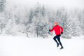 Happy girl running on snow in winter mountains - PhotoDune Item for Sale