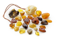 Natural amber. Many pieces of different colors of natural amber on white background - PhotoDune Item for Sale