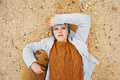 An adventurer young caucasian woman lying on grit ground beside - PhotoDune Item for Sale