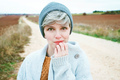 Woman with short and gray hair is alone in the beggining of a ru - PhotoDune Item for Sale