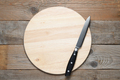 Empty wooden cutting board and knife on old wooden table top view - PhotoDune Item for Sale