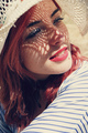 Young redhead woman covering from sun - PhotoDune Item for Sale