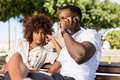 Outdoor protrait of black african american couple -  Girl bored - PhotoDune Item for Sale