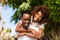Outdoor protrait of black african american couple - Guy carrying - PhotoDune Item for Sale