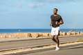 Black african american young man running outdoor - PhotoDune Item for Sale