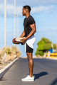 Black african american young man stretching after outdoor joggin - PhotoDune Item for Sale