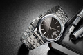 Steel wristwatch on black background - PhotoDune Item for Sale