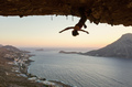 Female rock climber hanging upside down on challenging route  - PhotoDune Item for Sale