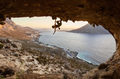 Young woman climbing in cave at sunset - PhotoDune Item for Sale