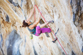 Young woman climbing challenging route on overhanging cliff - PhotoDune Item for Sale