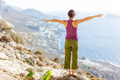 Young Caucasian woman practicing yoga while standing on cliff  - PhotoDune Item for Sale