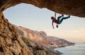 Caucasian man climbing challenging route  - PhotoDune Item for Sale