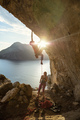 Male rock climber starting challenging route on cliff at sunset, - PhotoDune Item for Sale