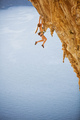 Young woman in bikini climbing challenging route over sea - PhotoDune Item for Sale