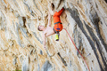 Young man climbing challenging route on overhanging cliff - PhotoDune Item for Sale