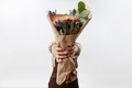 Lady's hands hold a nice bouquet from fresh fragrant flowers living coral colored roses on a - PhotoDune Item for Sale