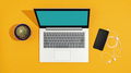 Laptop and smartphone on a bright yellow desk - PhotoDune Item for Sale