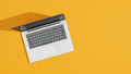 Laptop on a bright yellow desk - PhotoDune Item for Sale