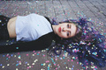 Beautiful young woman surrounded by confetti - PhotoDune Item for Sale