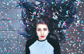 Cool young woman surrounded by confetti - PhotoDune Item for Sale