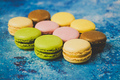 Variety of colorful macarons over a blue background - PhotoDune Item for Sale