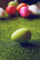 A beautiful and colorful close-up of green easter egg over green - PhotoDune Item for Sale