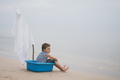 One little boy playing on the beach at the day time. - PhotoDune Item for Sale